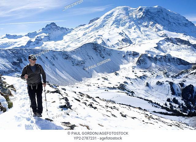 Mount Rainier National Park, Washington: Man hiking along Mount Fremont Lookout Trail near Sunrise