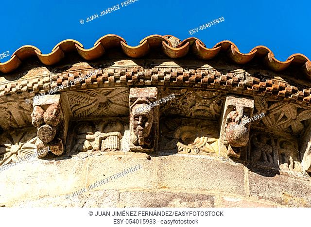 Close up of decorated corbels in the cornice of the apse of a Romanesque church of Villanueva de Cangas in Asturias, Spain, Europe