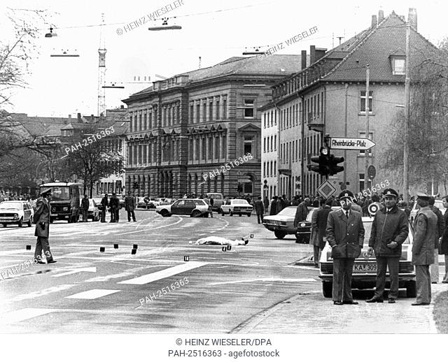 The covered corpse at the scene of crime. The highest prosecutor of the Federal Republic of Germany was killed through shots from a machine gun