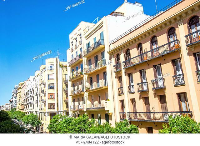Facades of houses. Lope de Rueda street, Madrid, Spain