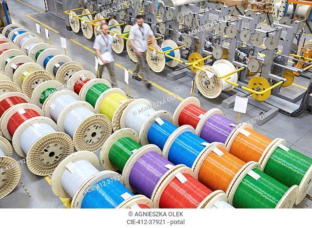 Elevated view multicolor spools in fiber optics factory