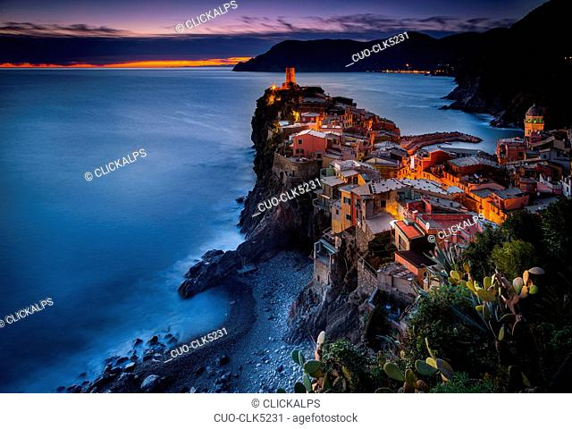 View of the village during sunset, with trees on the foreground and the sea on the background, Vernazza, Cinque Terre National Park, Ligury, Italy