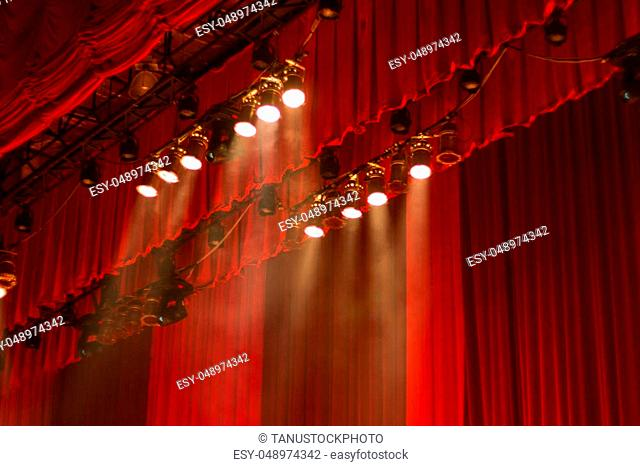 Red curtains and lights on stage at the show