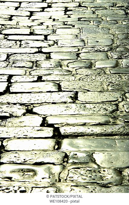Sun reflexing in the stone pavement in Hvar town, Croatia