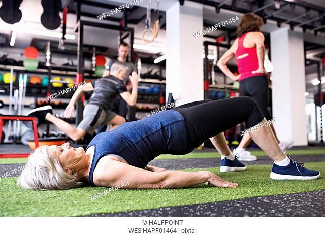 Fit senior woman exercising in gym