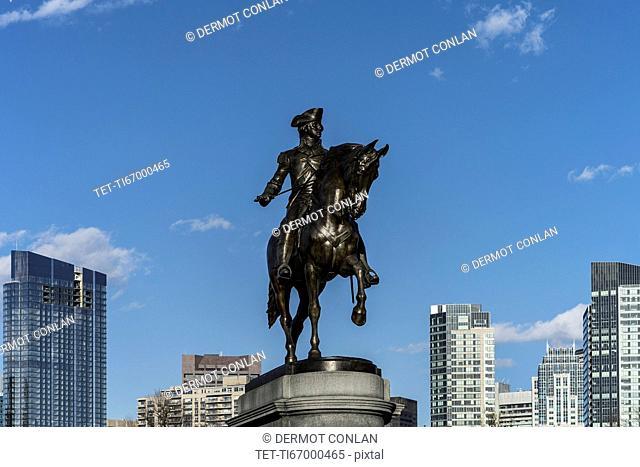 Massachusetts, Boston, Statue of George Washington against blue sky in Boston Public Garden
