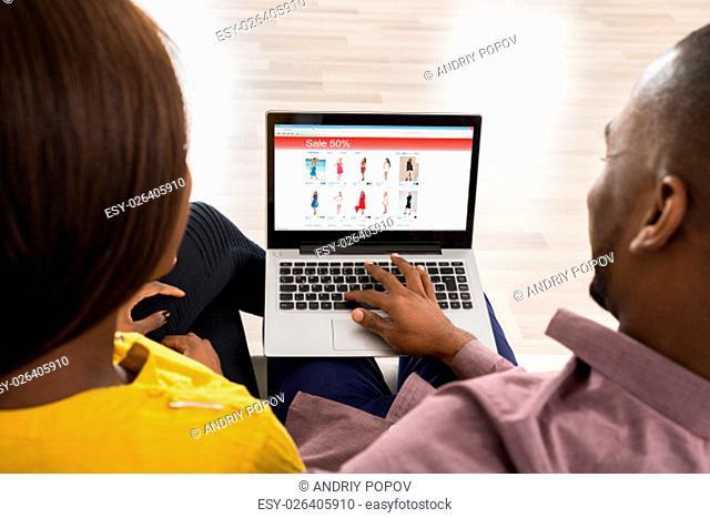 Close-up Photo Of Couple Shopping On Laptop
