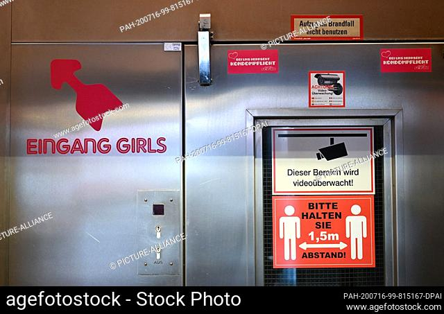 """16 July 2020, Hessen, Frankfurt/Main: Stickers with the inscription """"""""Eingang Girls"""""""" and """"""""Bitte halten Sie 1, 5m Abstand"""""""" (Please keep a distance of 1"""