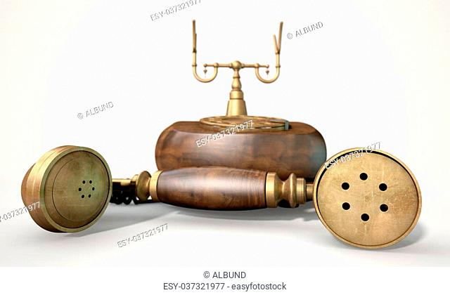 A vintage wood and brass telephone with dial embellishments and the handset lying off the hook on an isolated white studio background