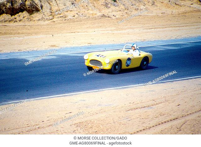 Action view at speed of Mr. Jordan King driving his yellow AC Ace Bristol No. 246 down the track at the Sports Car Club of America's National Races event in...