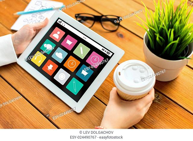 business, media, technology, people and advertisement concept - close up of woman with menu icons on screen on tablet pc computer screen and coffee cup on...