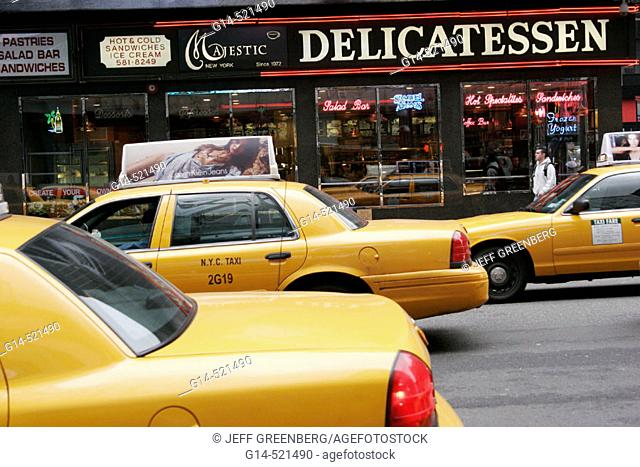 New York, Manhattan, 7th Avenue, West 50th Street, Majestic Delicatessen, yellow taxi cabs