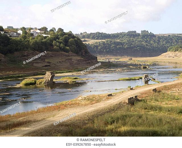 Empty reservoir. This reservoir is called Belesar and it is located in Lugo