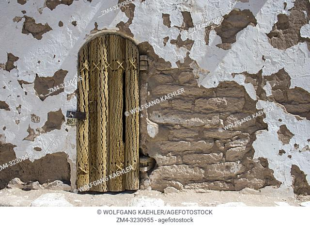 The door of the bell tower of San Lucas in the oasis town of Toconao near San Pedro de Atacama in the Atacama Desert, northern Chile is made from the wood of...
