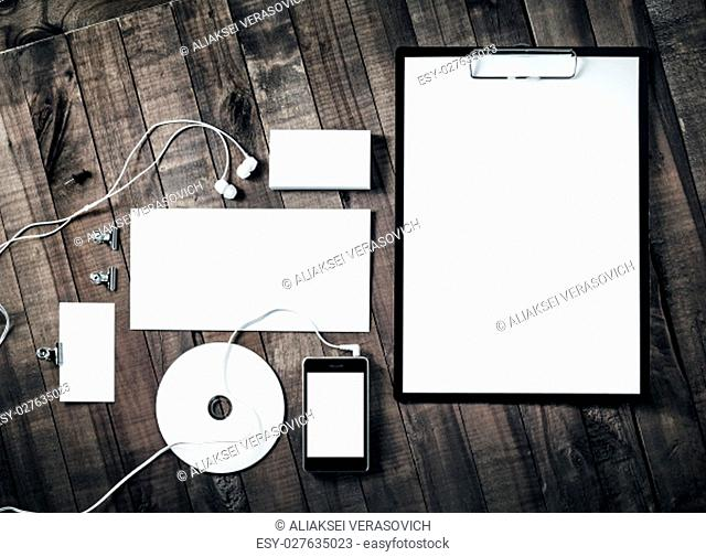 Blank stationery set and corporate identity template on wooden table background. Blank objects for placing your design. Branding ID mockup. Top view