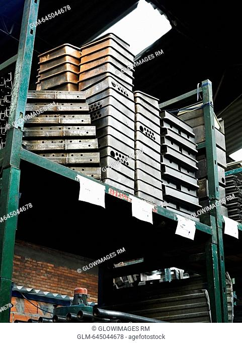 Low angle view of stacks of metal objects on a rack