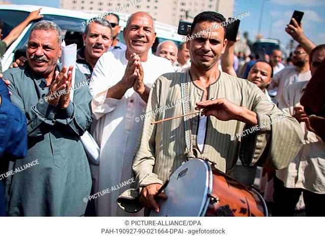 27 September 2019, Egypt, El-Mahalla El-Kubra: Supporters of Egyptian President Abdel Fattah el-Sisi gather for a pro-government rally in El-Mahalla El-Kubra