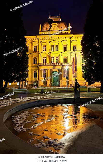 Illuminated facade of Maribor University building
