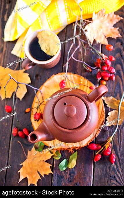 fresh tea in teapot on the wooden table