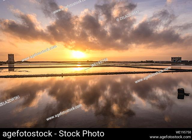 Sunset over Saline di Nubia natural reserve - Nubia saltworks in Nubia hamlet in municipality of Paceco, province of Trapani, Sicily, Italy