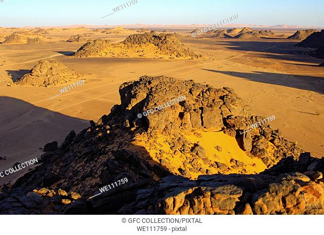 Desertscape with eroded rock hills in the Acacus Mountains, Sahara desert, Libya