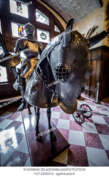 Full knight and horse armour in Grand Armory Hall in Peles Palace, former royal castle, built between 1873 and 1914, located near Sinaia city in Romania