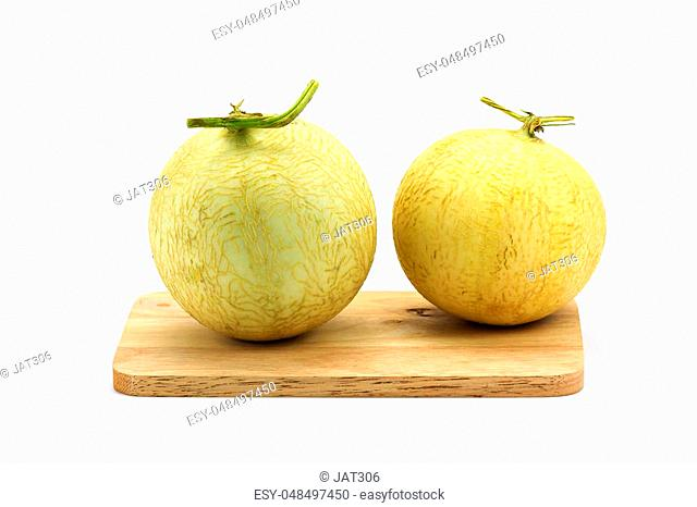 Cantaloupe on chopping board isolated on white