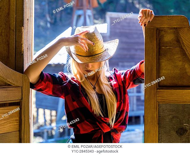 Country-girl attractive young woman hiding face
