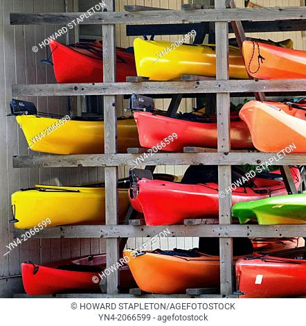 Kayaks stacked on a rack out of water