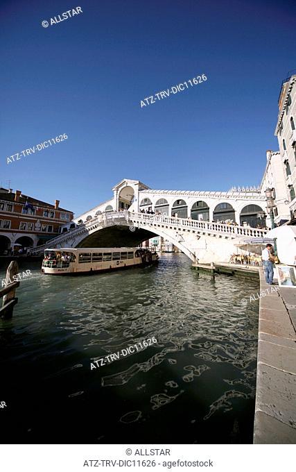 PUBLIC FERRY, THE RIALTO BRIDGE OVER THE GRAND CANAL; VENICE, ITALY; 10/09/2010