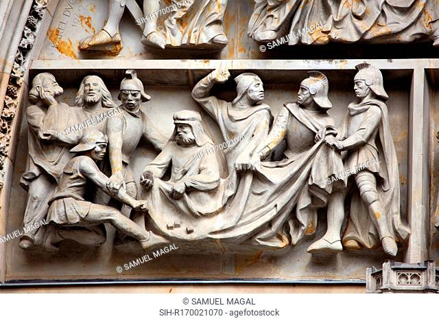 Tympanum Reliefs Above the Bronze Door of the central portal in the St. Vitus Cathedral's western facade, depicting a game of dice for in order to win Christ's...