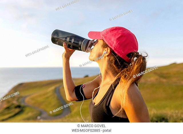 Young woman drinking from bottle
