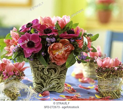 Arrangement of Anemone coronaria, tulips & forget-me-nots