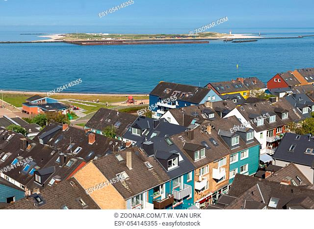 Aerial view at houses of German island Helgoland and a view at the nearby island Dune