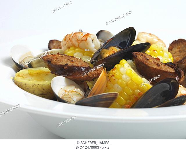 Seafood stew with sausage, potatoes and corn