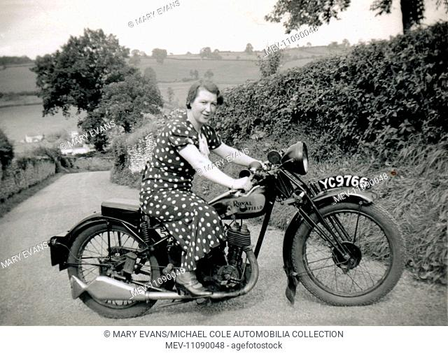 Lady on 1929 Royal Enfield 350cc side valve motorcycle in a country lane circa 1930