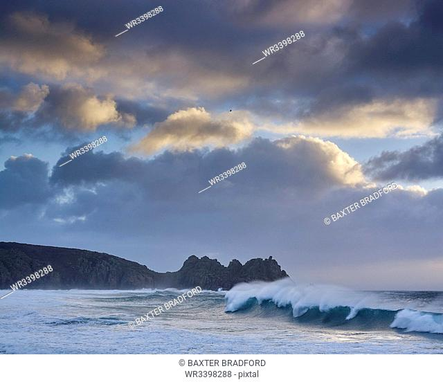 Huge surf looking out towards Logan Rock at Porthcurno, Cornwall, England, United Kingdom, Europe