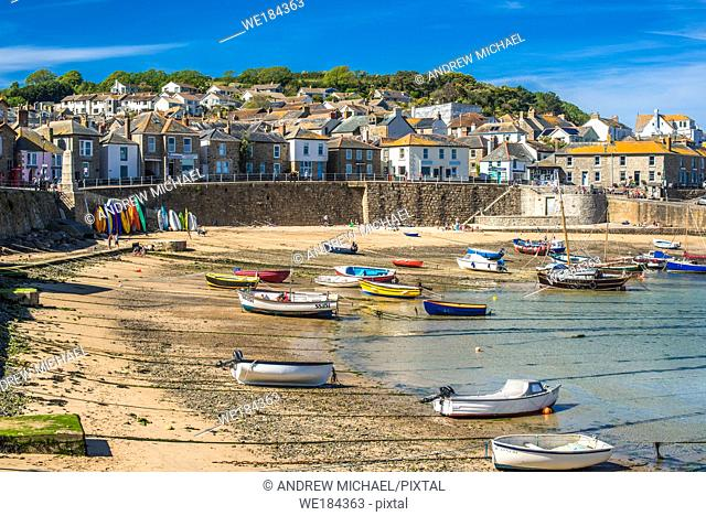 Small fishing boats in Mousehole harbour Cornwall England GB UK EU Europe