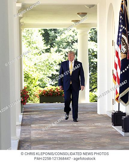 United States President Donald J. Trump walks on the Colonnade to make remarks in the Rose Garden of the White House in Washington