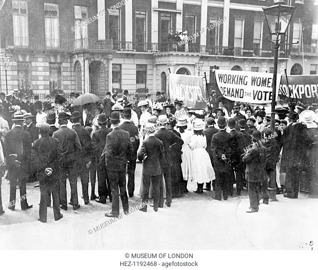 A small crowd watches the Women's Sunday procession as it passes Portland Place, 21 June 1908. The protesters are almost at the end of their walk to Hyde Park