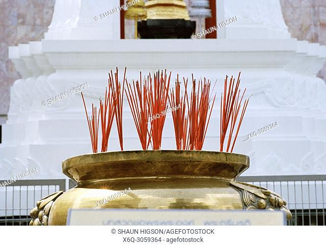 Incense at the Trimurti statue God of Love at Central World in Bangkok in Thailand in Southeast Asia Far East