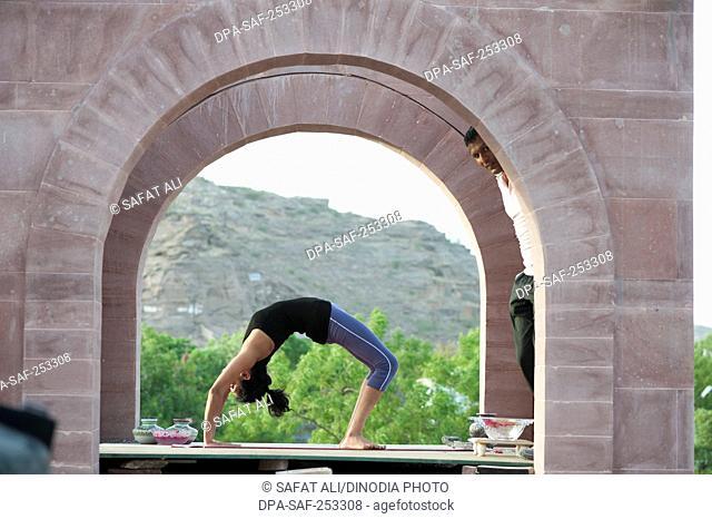 Woman doing urdhva dhanurasana, rajasthan, india, asia, mr#746b