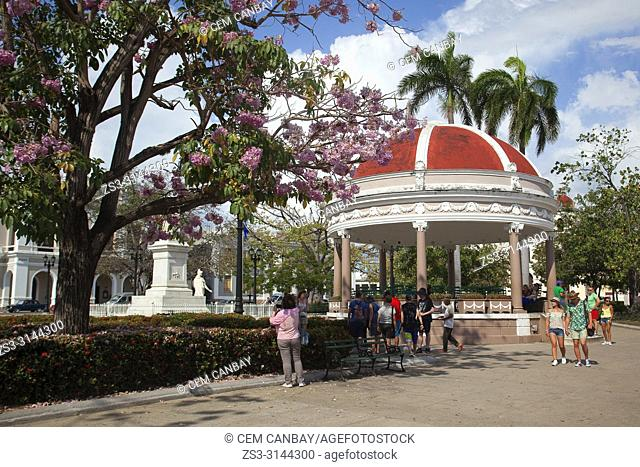 Tourists in front of the Pavilion at Parque Jose Marti in Plaza de Armas Square at the historic center, Cienfuegos, Cuba, West Indies, Central America