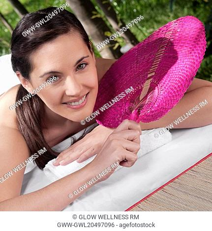 Portrait of a woman lying on a massage table and smiling