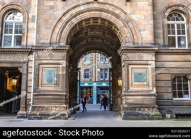 El Cartel restaurant and gate of one of building of University of Edinburgh in Edinburgh, the capital of Scotland, part of United Kingdom