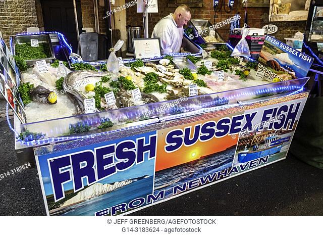 England, London, South Bank Southwark, Borough Market, vendors stalls, Fresh Sussex Fish, fishmonger, ice bin, man, display sale, seafood