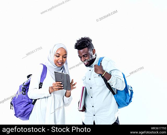 portrait of happy african students standing together against white background girl wearing traidiional sudan muslim hijab fashion
