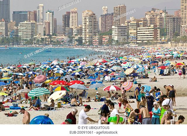 Benidorm. View of crowded beach lined with high rise hotels