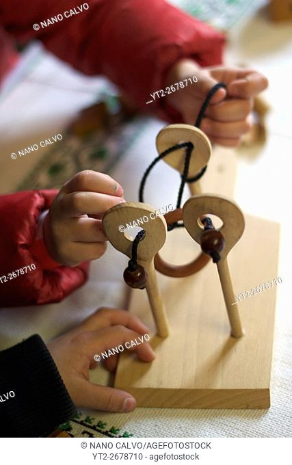 Wooden puzzle games. Traditional costumes and folk traditions at Easter Festival in Hollók?, UNESCO World Heritage-listed village in the Cserhát Hills of the...