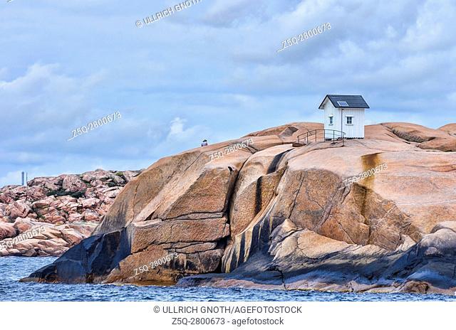 Wooden hut on a granite rock on the coast of the natural preserve (Stångehuvuds naturreservat) off Lysekil, Bohuslan, Sweden